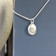 Pebble heart charm